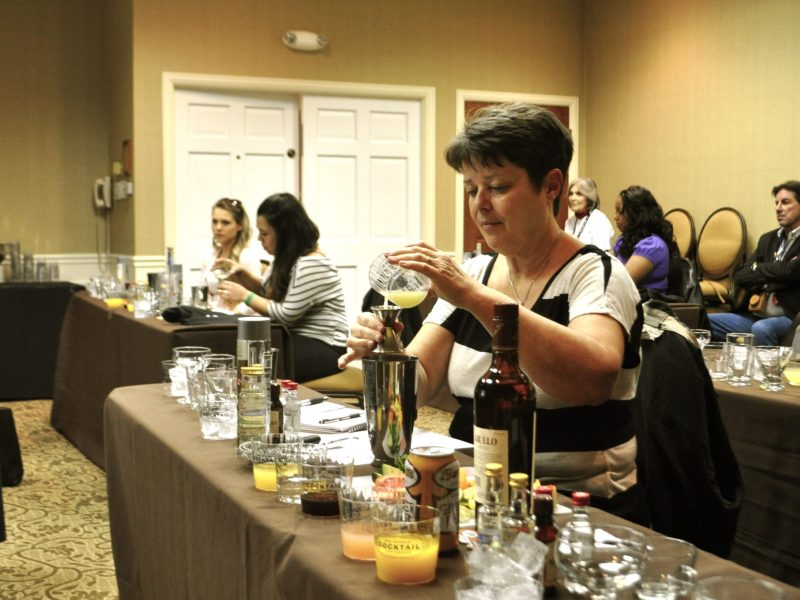 "Charla Marsh measures out ingredients for a classic rum Daiquiri during ""Mixology 101"" at the 2014 San Antonio Cocktail Conference. Photo by Iris Dimmick."