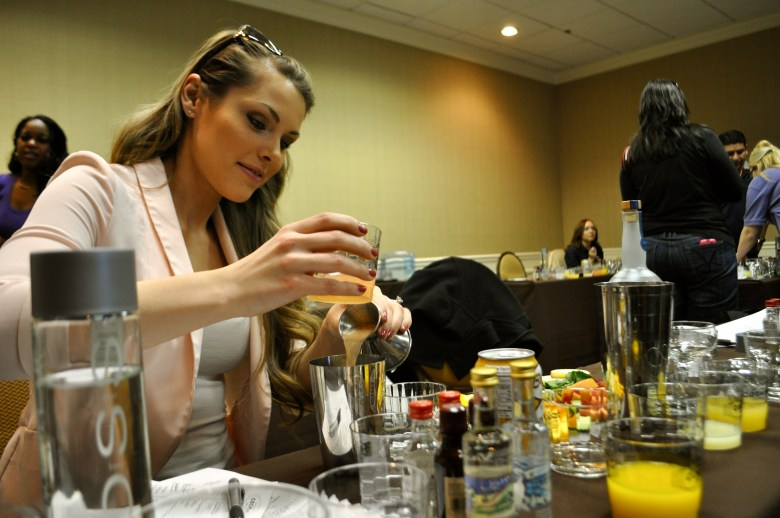"""Megan Fleming, bartender at The Blue Door bar in Midland, Texas, experiments with a wide range of ingredients during """"Mixology 101"""" at the 2014 San Antonio Cocktail Conference. Photo by Iris Dimmick."""