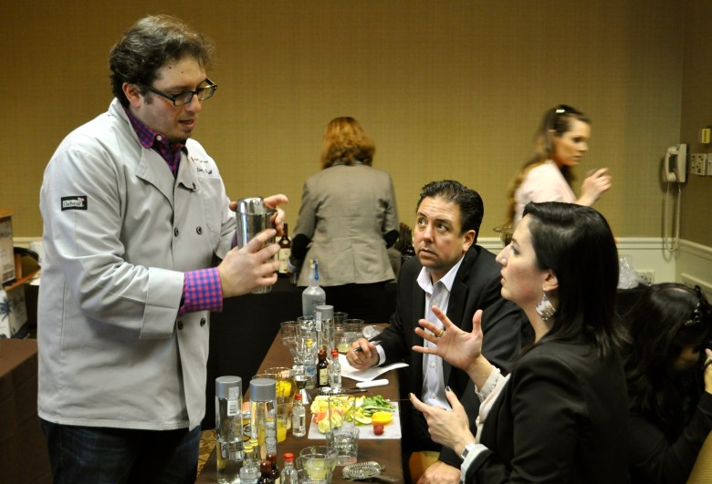 """Jonathan Pogash demonstrates proper cocktail shaking technique to students at """"Mixology 101"""" during the San Antonio Cocktail Conference. Photo by Iris Dimmick."""