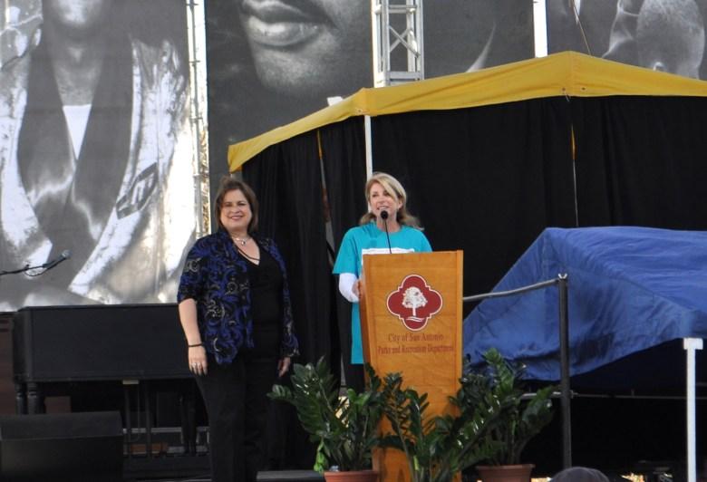 Texas State Senators Wendy Davis (right) and Leticia Van De Putte address the large crowd gathered for San Antonio's 2014 MLK Day celebration in Pittman-Sullivan Park. Photo by Iris Dimmick.