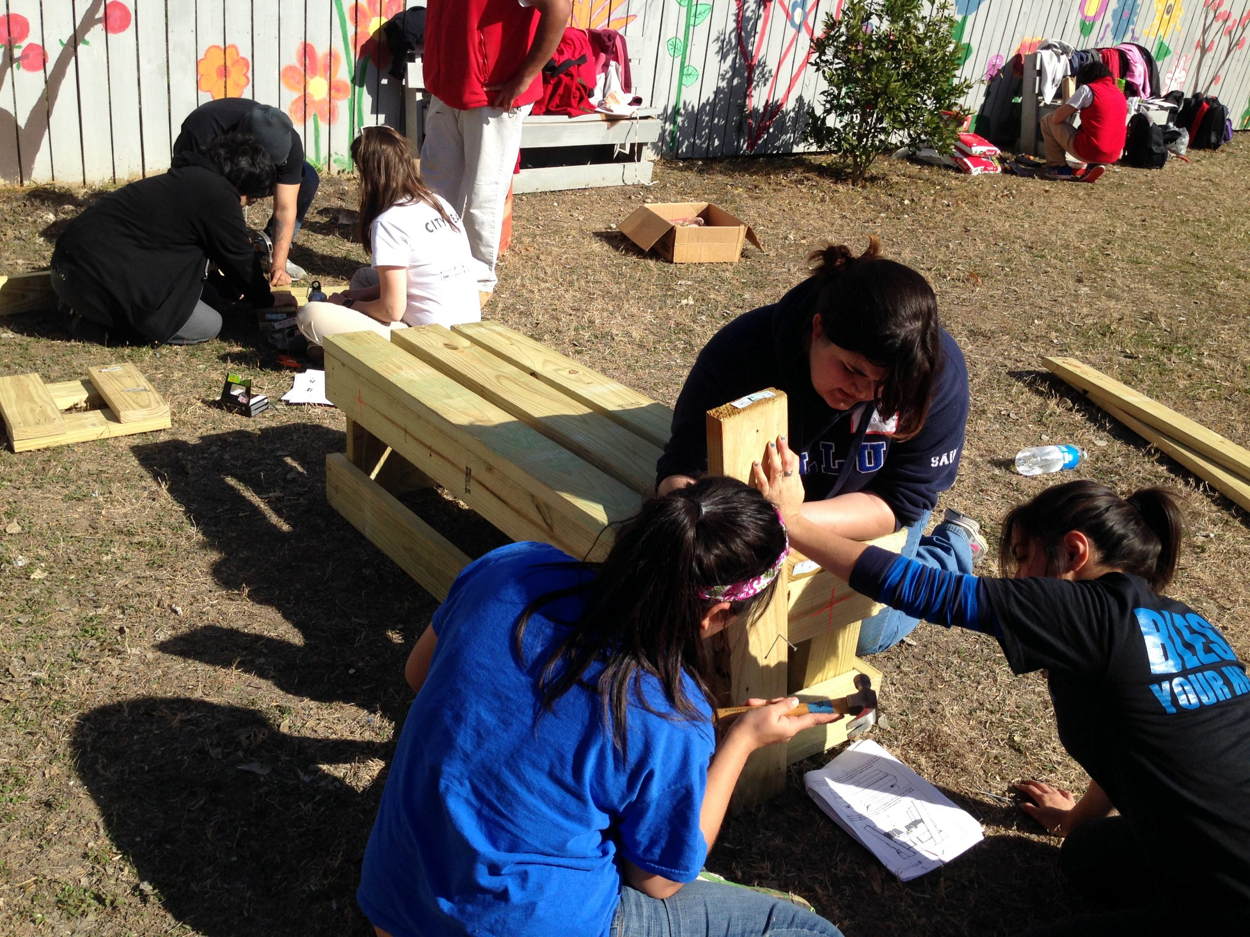 Our Lady of the Lake University students build benches for the community at the Adult Day Care Center. Photo by Karl Brooks.