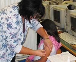A child receives a flu shot. Photo courtesy of San Antonio Metropolitan Health District.