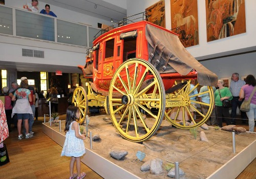 Wells Fargo & Co. Nine-Passenger Western Mail Stagecoach, replica, built by Jay Lambert, ca. 1975, wood, steel, leather and fabric, purchased with funds provided by the Amy Shelton McNutt Charitable Trust and the Mark C. Lemons Foundation