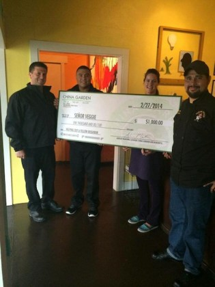 Adrian Martinez, Owner and CEO of China Garden, along with Chris Benitez, co-owner of Whipstitch present a check for $1000 to Señor Veggie owner, José Cruz and Leah Pettway Williams, Front of the House Manager. Courtesy photo.