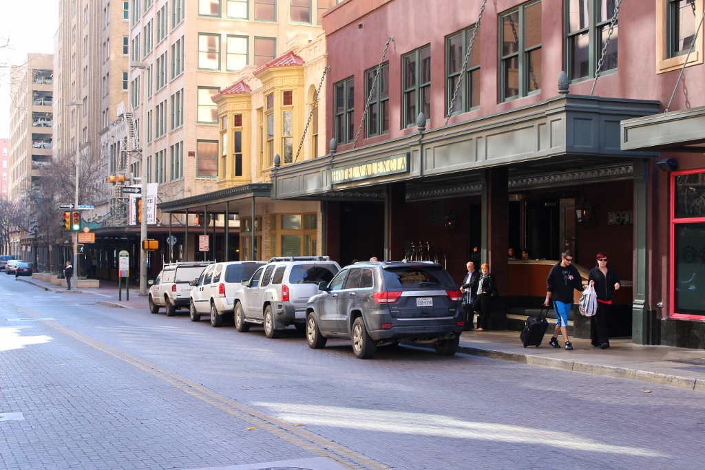 Frenetic activity often occurs in this small loading zone in front of the Hotel Valencia on Houston Street. Photo by Page Graham.