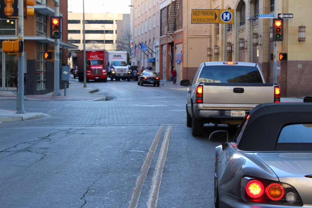 Delivery trucks trying to squeeze down narrow streets between loading zones is a common sight downtown. Photo by Page Graham.