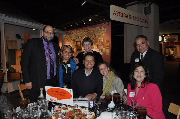 """Conversation leader Raul Lomeli-Azoubel, executive chairman of SABEResPODER (center) with participants of the """"Great Moments in Mariachi Music"""" conversation table for the UTSA Great Conversations 2013 fundraiser. Photo by Iris Dimmick."""