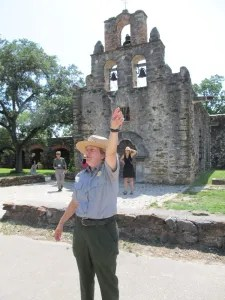 Archaeologist Susan Snow of San Antonio Missions National Historical Park leads ICOMOS symposium visitors on a tour of Mission Espada in May 2012.