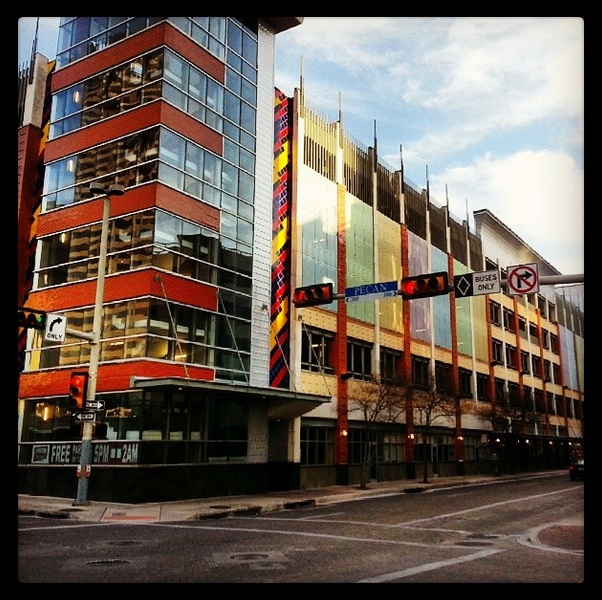 Parking garage on the corner of East Pecan Street and North St. Mary's Street. Photo by Iris Dimmick via Instagram.