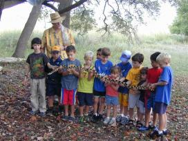 Children hold a big snake during a nature tour at Cibolo Nature Center and Farm. Courtesy photo.