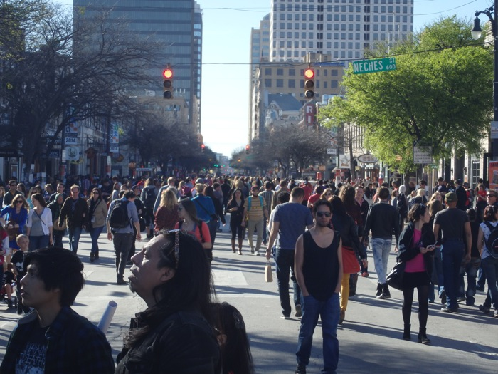 The infamous 6th Street during the first day of music at SXSW 2014. Photo by Mile Terracina.