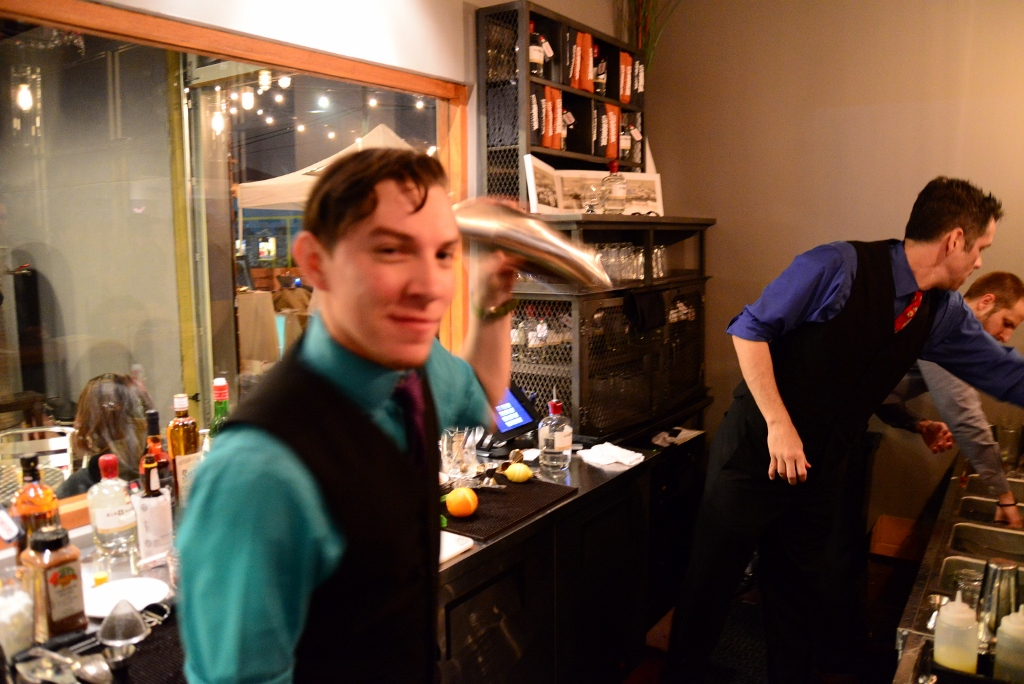 Bartender Nick Kenna mixing a cocktail at Dor?ol Distillery. Photo by Page Graham.