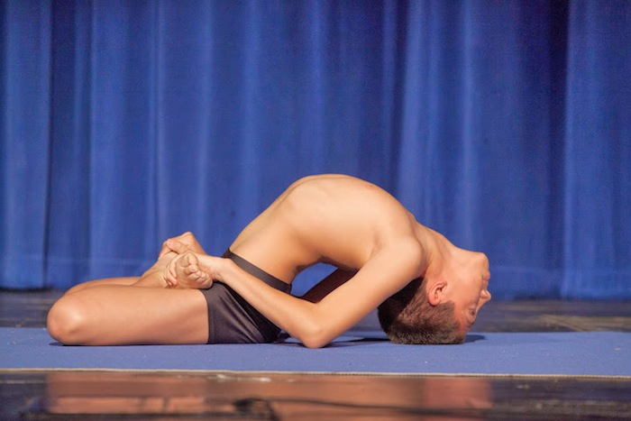 """Youth Male Alankane D'Quebec executes the """"stretching"""" pose during the 2014 National USA Yoga Asana Championship at the Aztec Theatre March 14-16. Photos by Stacy Pape/USA Yoga Federation."""