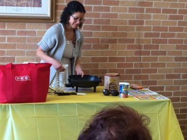 Maria Palma give a cooking demonstration at Arnold Elementary School