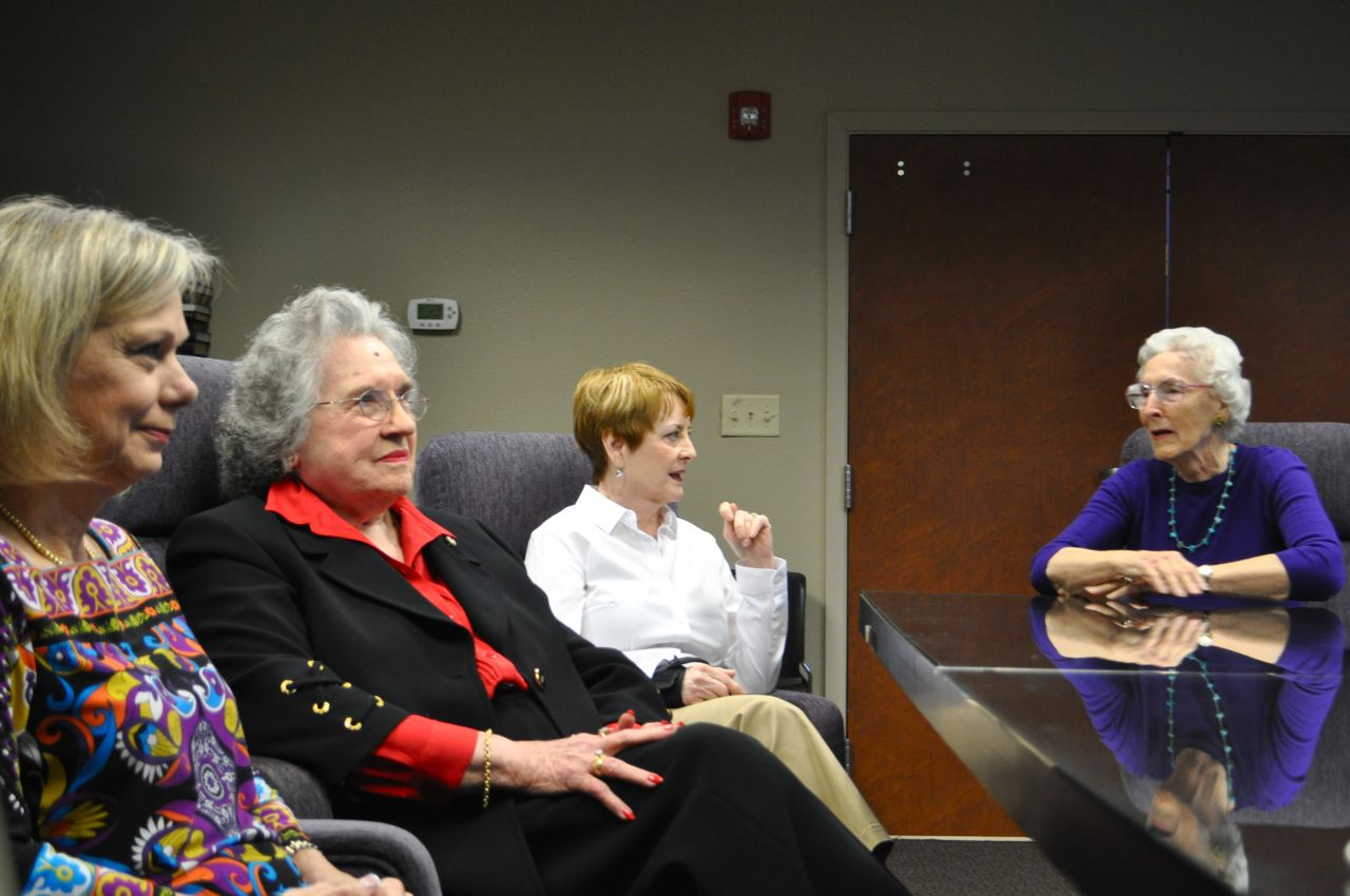 From left: Jo Vanderver, Elaine Portie, Patricia Leer, and Jonnie Schulz share memories of Cameron Redus. Photo by Iris Dimmick.
