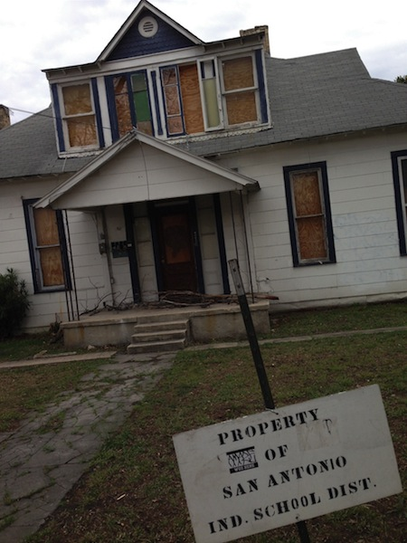 A house directly behind Bonham Academy purchased by SAISD. A request by the district to demolished the abandoned home was denied by the Historic Design and Review Commission. Photo by Michael Taylor.