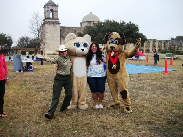 Mascot Chips the dog and Salsa the Cat from Animal Care Services post for a photo with Get Outdoors organizers. Photo by Carol Baas Sowa.