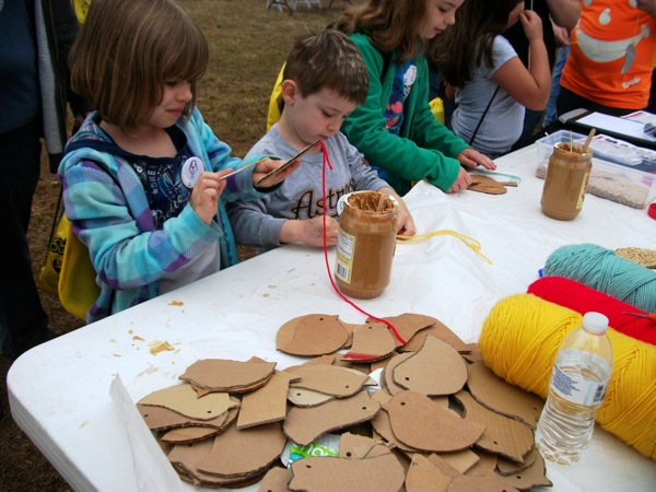 The San Antonio River Authority's peanut butter bird house booth at the 2014 Get Outdoors! event at Mission San Jose. Photo by Carol Baas Sowa.