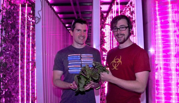 "Rackspace co-founder Pat Condon (left) and LocalSprout CEO Mitchell Hagney pose a photo in the fushia ""farm."" Photo by Iris Dimmick."