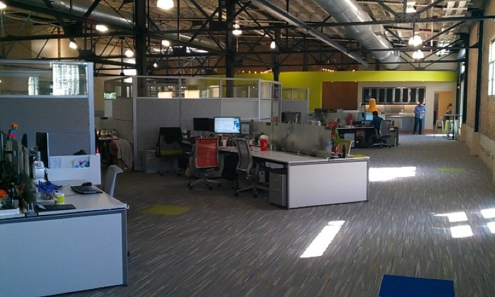 Peer 1's new office has significantly more free space and uses sunlight as well as interior lighting