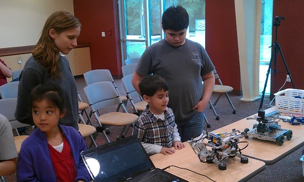 Screaming Chickens robotics team gave a robotics demonstration to other kids in the community using Lego Mindstorms robots.