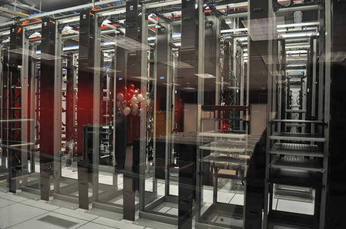 Among other small startups, Rackspace hosted the first three servers for YouTube, which remain behind glass at the Open Cloud Academy. Photo by Iris Dimmick.