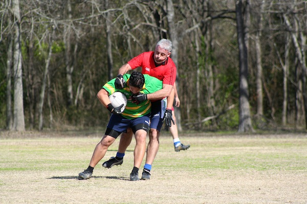 Rick Ortiz and Kevin McManus, a Portaferry native, fight for possession during a recent Pub League game. Photo by Carolyn Villarreal.