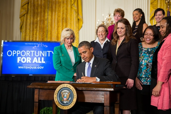 President Barack Obama signs executive actions to strengthen enforcement of equal pay laws for women, at an event marking Equal Pay Day, in the East Room of the White House, April 8, 2014. Official White House Photo by Pete Souza.
