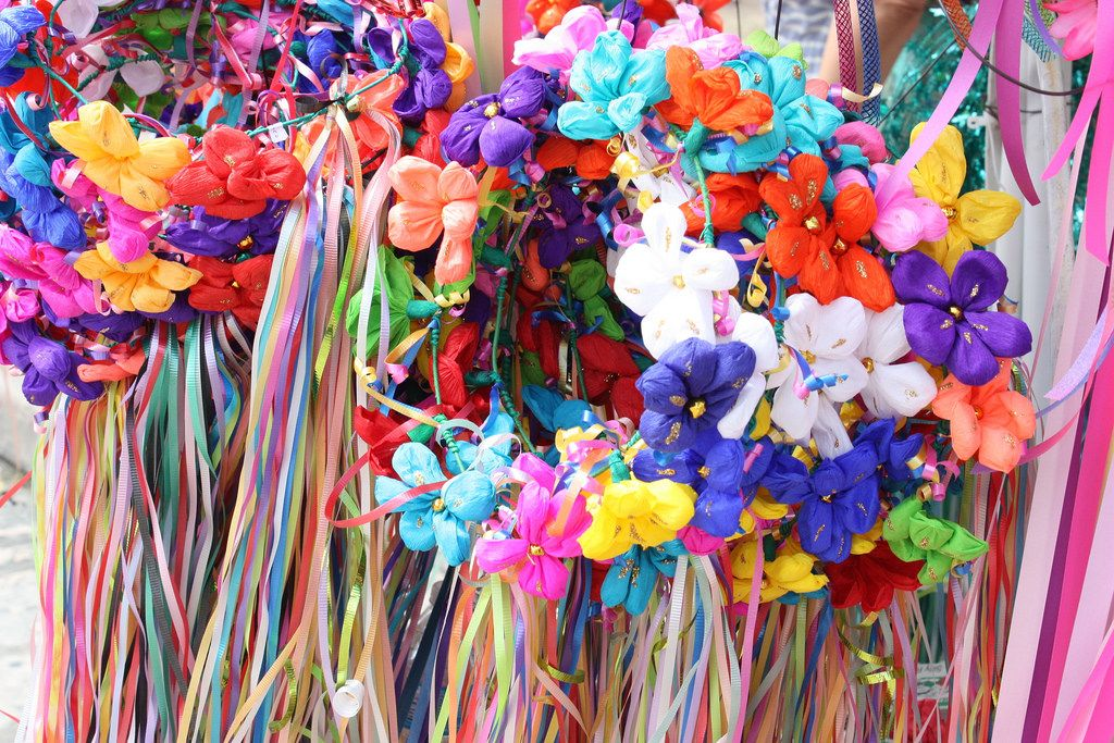 These flower head leis are always sold at the Battle of Flowers Parade, April 25, 2014. Photo by Kay Richter.
