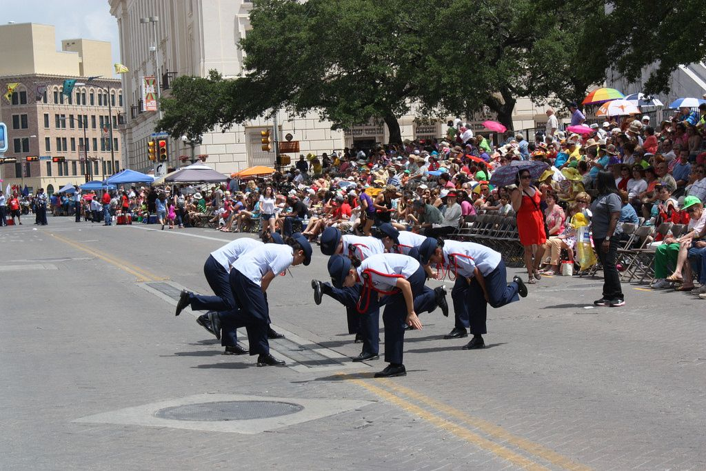 Members of the John Paul Stevens High School Air Force JROTC perform along the parade route while at the Battle of Flowers Parade, April 25, 2014. Photo by Kay Richter.