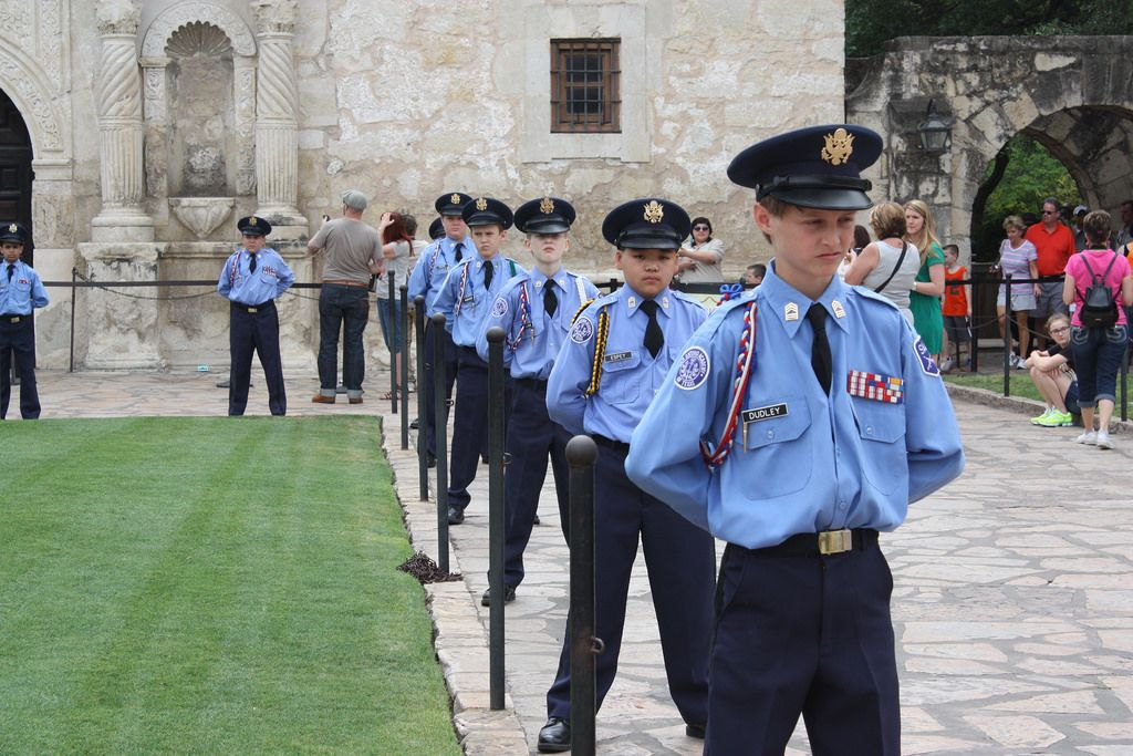 The junior guards protect the sacred ground of the Alamo as they wait for their floral tributes to arrive. They stand at attention at the Battle of Flowers Parade, April 25, 2014. Photo by Kay Richter.