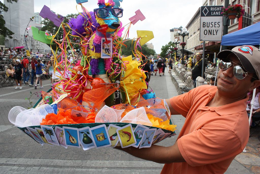 This Fiesta reveler had one of the most impressive hats of the season and proudly shows his treasure at the Battle of Flowers Parade, April 25, 2014. Photo by Kay Richter.