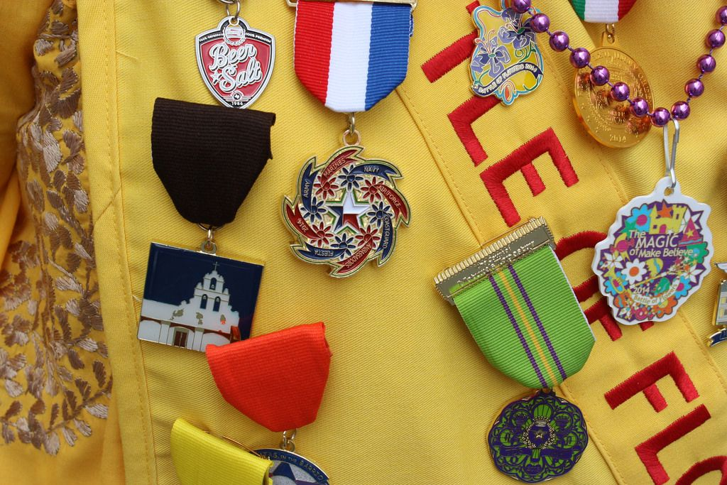 Nancy, a parade volunteer, proudly displays her Fiesta medals while at the Battle of Flowers Parade, April 25, 2014. Photo by Kay Richter.