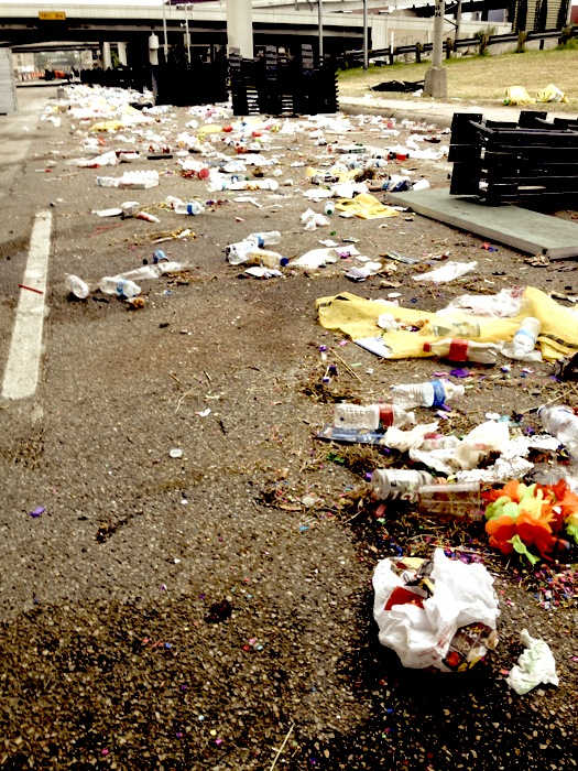 Litter lines Broadway at I-35 the morning after the Fiesta Flambeau. Photo by Robert Rivard