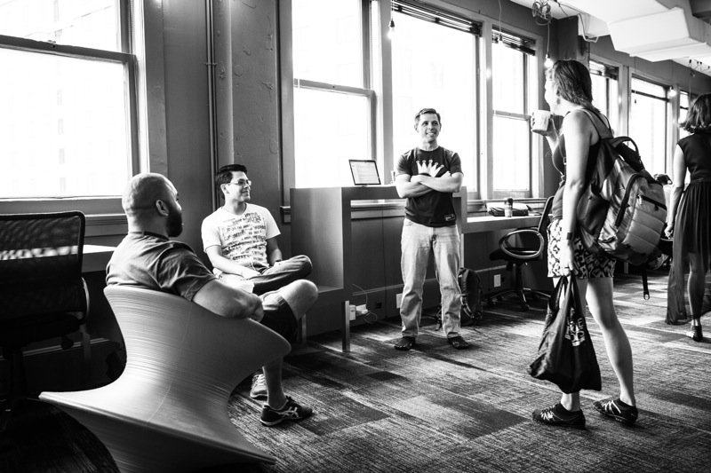 Geekdom staff and members utilize the new Geekdom co-working space in the Rand Building. Photo by Kara Gomez.