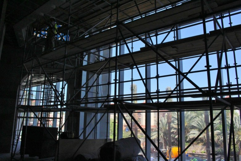 The view from the Frost Studio Lobby onto the Riverwalk is currently obscured by scaffolding. Photo by Page Graham.