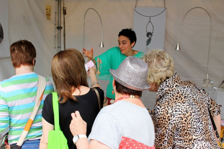 Selling to the crowd at Fiesta Arts Fair. Photo by Page Graham.