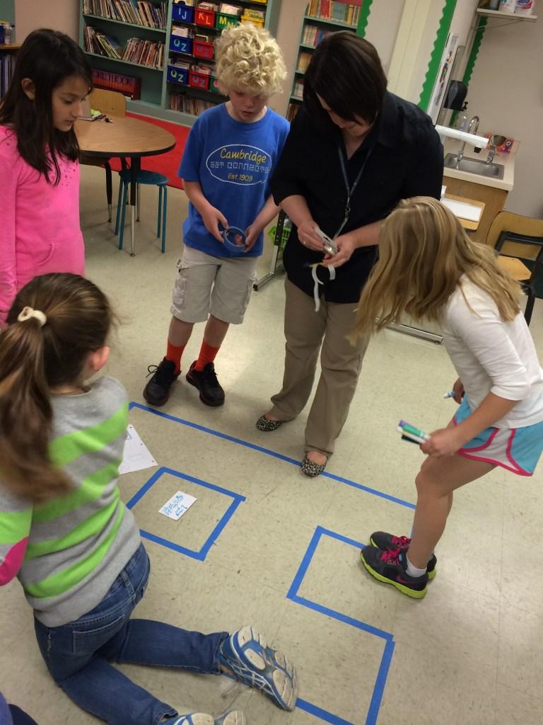 "Cheryl Duckers with Cambridge ES third-graders enjoying ""Perimeter-palooza."""