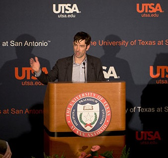 Brian Janous, director of energy strategy at Microsoft, announces the UTSA-Microsoft research collaborative. Photo Mark McClendon of UTSA.