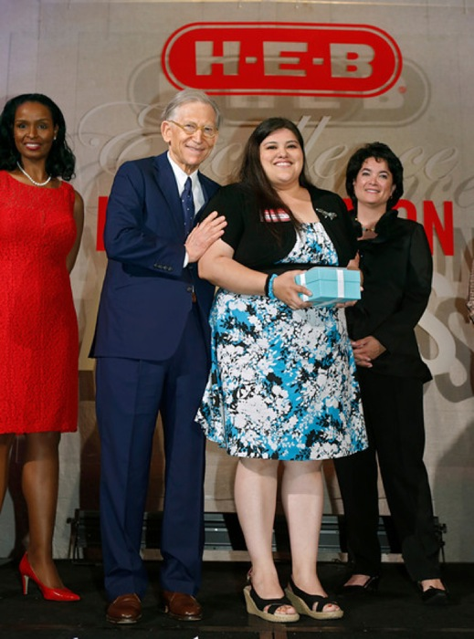 Rising Star Elementary category winner Celena Miller of Cesar Chavez Elementary School in Pharr, Texas with H-E-B chairman and CEO Charles Butt at the H-E-B Excellence in Education Awards at the Grand Sonesta Hotel in Houston, Texas Saturday May 3, 2014. Photo courtesy of H-E-B.
