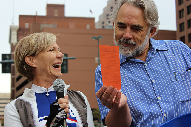 Cindi Snell and Moderator Robert Rivard laugh together on stage during the San Antonio before the 2014 MPO Walk & Roll Rally May 2, 2014. Photo by David CohenMiller.