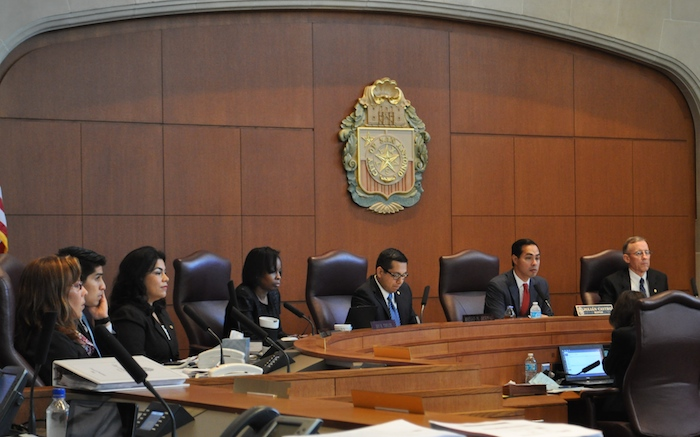 San Antonio City Council members (from left) Shirley Gonzales, Rey Saldaña, Rebecca Viagran, Ivy Taylor, Diego Bernal, Mayor Julián Castro, and Mike Gallagher discuss SAWS' Impact Fee increase in Council chambers. Photo by Iris Dimmick.