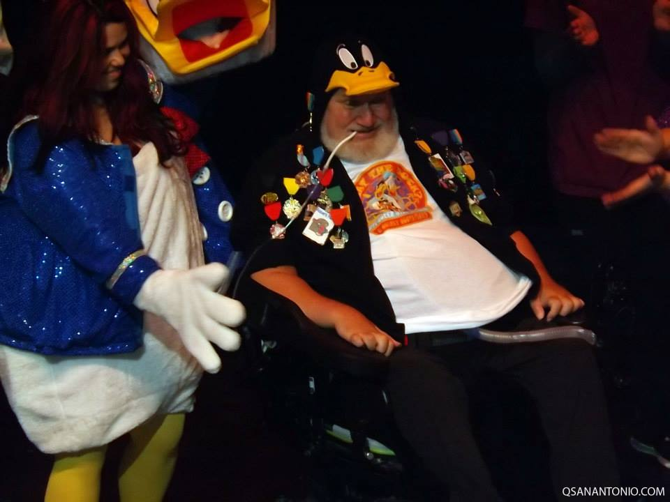 Robert Rehm, local theatre arts icon, dressed as Daffy Duck for the 2014 Cornyation performance. A scholarship for high school seniors was set up by the Cornyation Board of Directors in 2006 after a fall into an orchestra pit in 2005 left him paralyzed, but Rehm remains active in the San Antonio Arts Community. Photo courtesy of QSanAntonio.com.