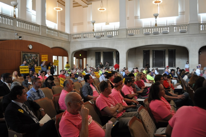 Ride service technology supporters in pink and their opposition in yellow at the City Council Public Safety Committee meeting May 7, 2014. Photo by Iris Dimmick.
