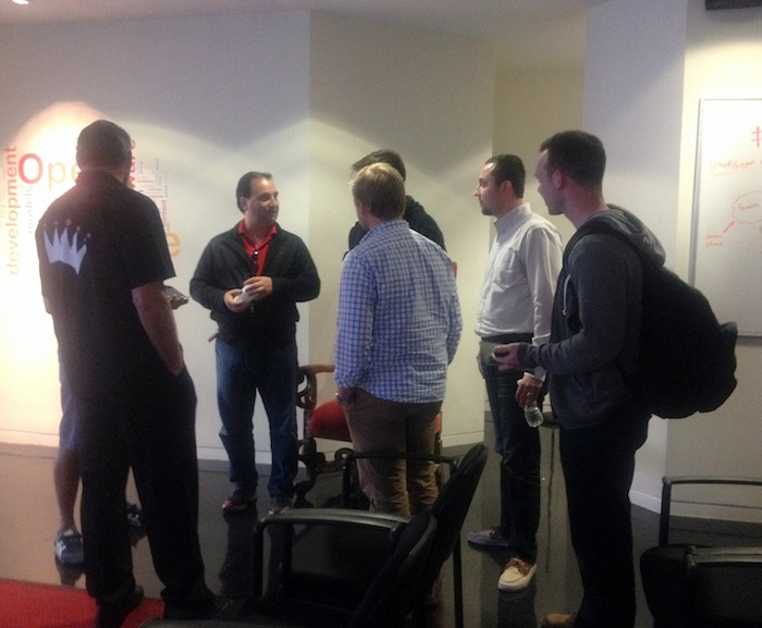 A group of presenters and mentors chat after the pitches ended. Geekdom's former headquarters. Photo by Lily Casura.
