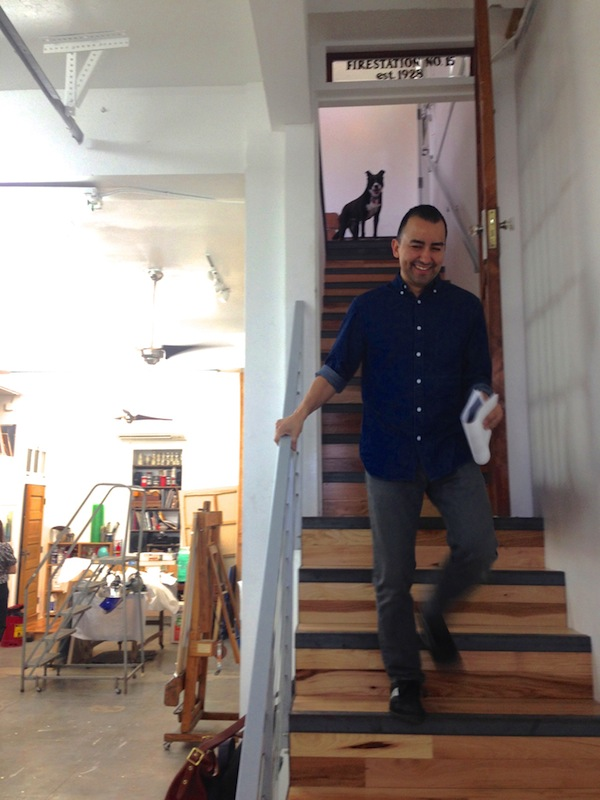 Vincent Valdez descends the staircase from his home into his studio. Photo by Taylor Browning.