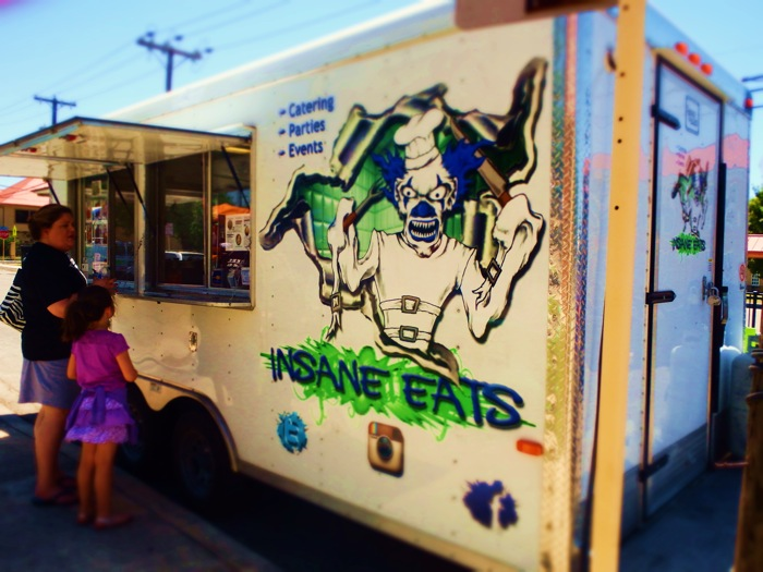 Fredstock included a variety of arts and crafts vendors selling t-shirts, paintings, & DIY goods, Insane eats food truck was parked nearby.