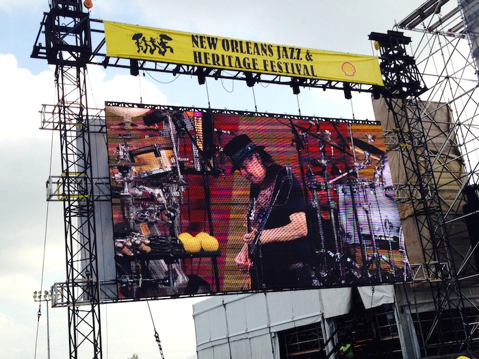 The big screen at the 2014 New Orleans Jazz and Heritage Festival. Photo by Adam Tutor.