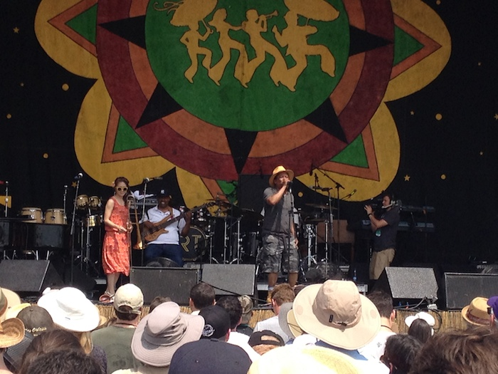 Kermit Ruffins and the Barbeque Swingers break it down in the shade of Congo Square during 2014 Jazz Fest in New Orleans. Photo by Adam Tutor.