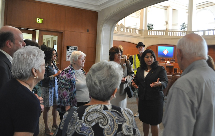 District 3 Councilwoman Rebecca Viagran speaks with COPS Metro Alliance and Trinity Lutheran Church representatives after City Council approved bike lane removal on South Flores Street. Photo by Iris Dimmick.